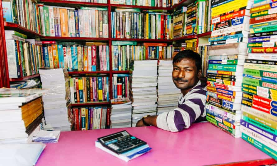 Man selling used books at the largest second-hand book market in the world on College Street in Kolkata, India.