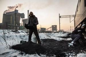 A man scavenging coal