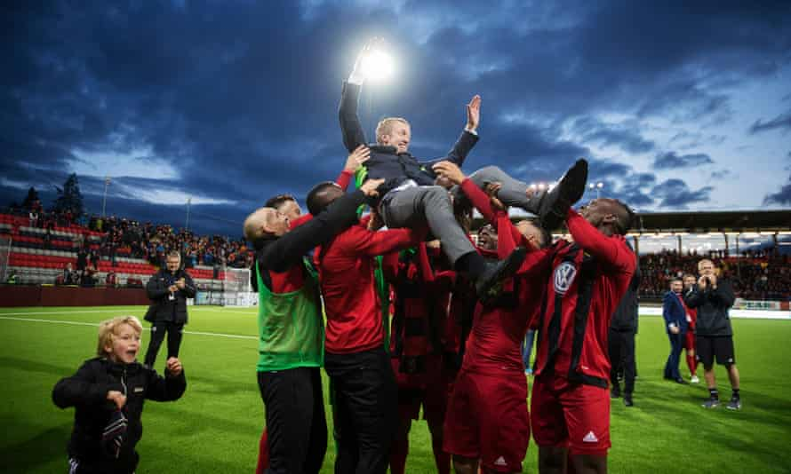 Graham Potter is held aloft by his Östersund players following their Europa League qualifying victory over round PAOK at the Jämtkraft Arena in August.