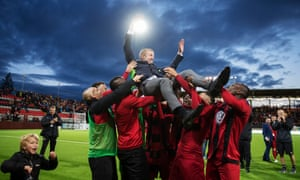 Graham Potter is borne aloft by his Ostersund players after reaching the group stage of the Europa League in August by beating PAOK
