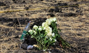 Flowers laid during a memorial service for victims at the crash site of Ethiopian Airlines flight ET302 in Bishoftu