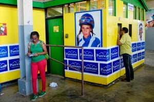 The walls of the stadium are adorned with posters of the jockeys, who are mostly revered and sometimes worshipped by the patrons and punters at the track