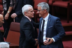 Queensland LNP Senator Gerard Rennick is congratulated by Malcolm Roberts after giving his first speech in the Senate Chamber of Parliament House, Canberra this evening.