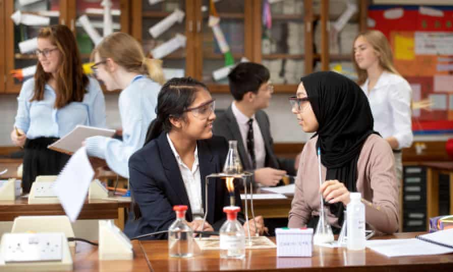 A-level chemistry students during a practical lesson in a secondary school.