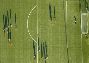 Players cast long shadows during a training session at the Adolf-Brühl Stadium