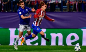 Leicester City's Marc Albrighton barges into Atlético Madrid's Antoine Griezmann outside the box.