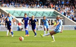 Toni Duggan scores the second for City.