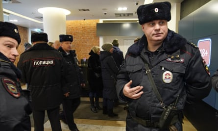 Police at the Pioner cinema in Moscow on Friday.