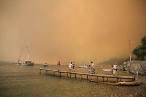 Tourists wait to be evacuated from Mazi, near Bodrum, Turkey