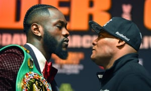 Deontay Wilder (left) faces off with Luis Ortiz before their fight in Brooklyn on Saturday.