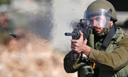An Israeli soldier fires a rubber bullet.