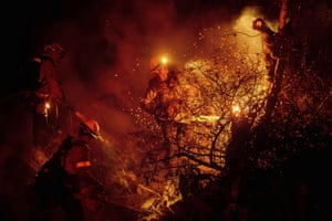 Fullerton, US Firefighters mop up a brushfire in California.