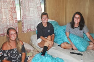 English backpackers Sophie Etheridge, Hattie Richards and Beth Longstaff in their caravan in Mildura
