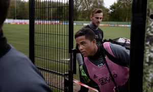 Ajax's Justin Kluivert leaves the training pitch.
