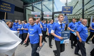 Ryanair pilots gather at the headquarters of the pilots' union during a 24-hour strike in August