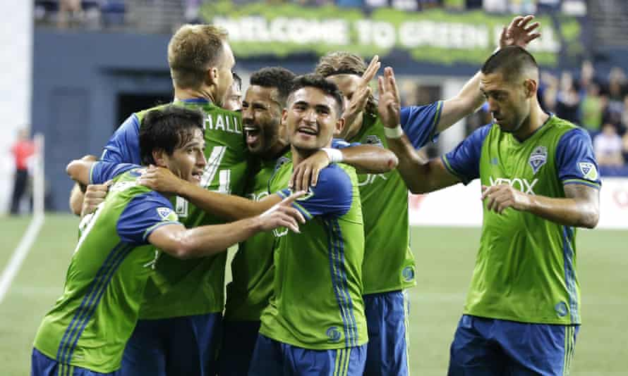 The Sounders celebrate as they head towards victory over the Timbers