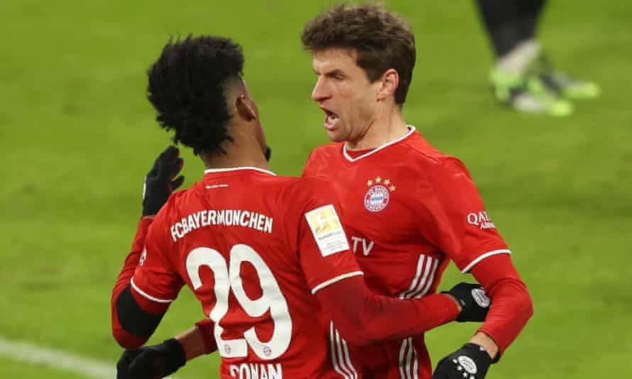 Bayern Munich's Thomas Müller celebrates with Kingsley Coman