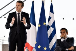 French President Emmanuel Macron (left) and Greek Prime Minister Alexis Tsipras (right) hold a discussion with French and Greek business leaders in Athens