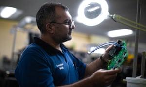 Zeeshan Malik tests printed circuit boards at the Siemens plant.