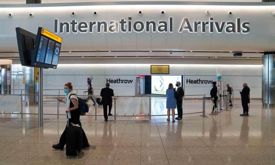 Travellers arrive at Heathrow airport.