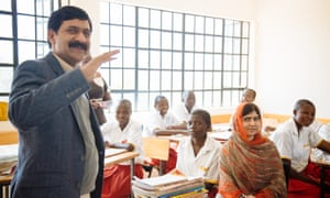 Yousafzai and his daughter Malala visit a school in Kenya as part of their work with the Malala Fund.