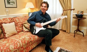 Guitarist and former prime minister Tony Blair.