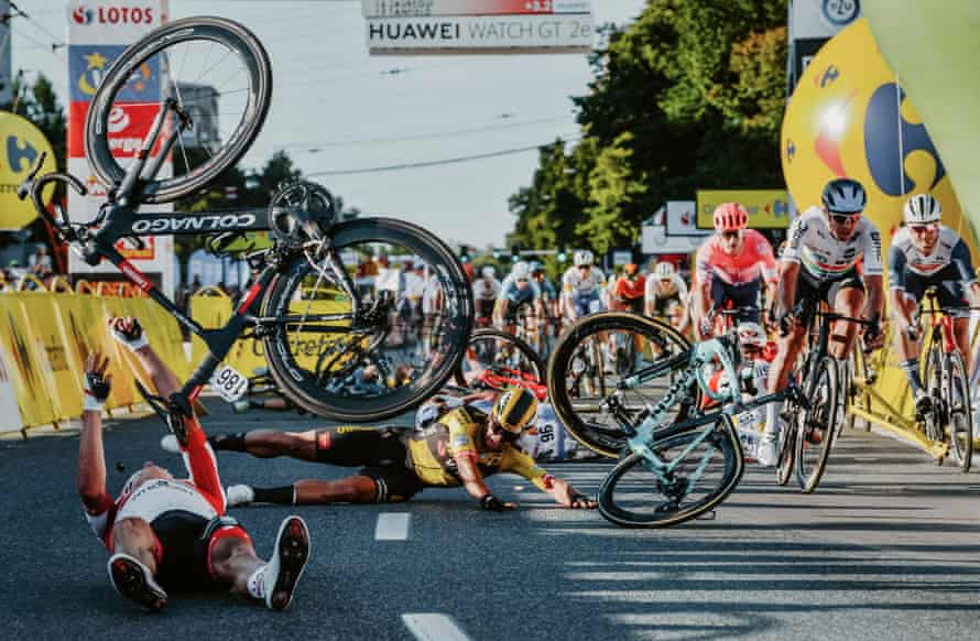 Dutch cyclist Dylan Groenewegen and fellow riders collide during the opening stage of the Tour of Poland in Katowice on 5 August,