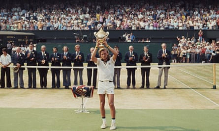 Bjorn Borg holds the Wimbledon trophy aloft after defeating Ilie Nastase of Romania for his first of five successive wins in 1976.