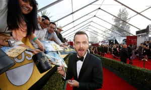 Meet and greet: signing autographs as he arrives at the 20th annual Screen Actors Guild Awards in Los Angeles.