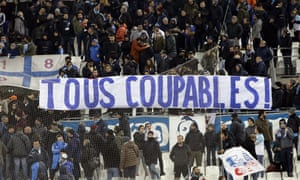 "Marseille fans display a banner reading ""All guilty"" after their 1-1 draw against Monaco at the Vélodrome."