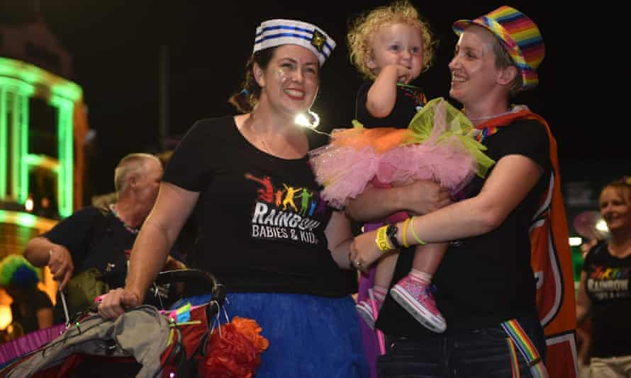 Families take part in the Sydney Gay and Lesbian Mardi Gras parade on Saturday