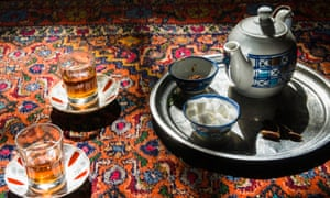 Tea set on a carpet, in Iran.