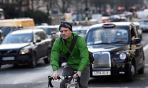 A cyclist passes along Marylebone Road in London.