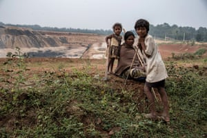 A local family on the edge of the Adani-managed Parsa East and Kanta Basan open cut coal mine.