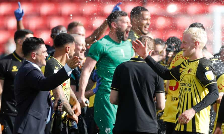 Watford's manager, Xisco Muñoz (shakes) the hand of Will Hughes after clinching promotion to the Premier League.