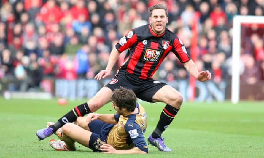 Mathieu Flamini fouls Bournemouth's Dan Gosling
