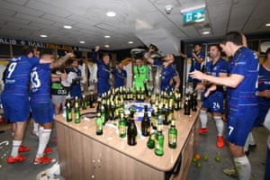 The Chelsea team celebrate victory in the changing room after the UEFA Europa League final.