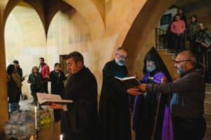 Archbishop Pargev Martirosyan during a night mass inside a shelter in Stepanakert