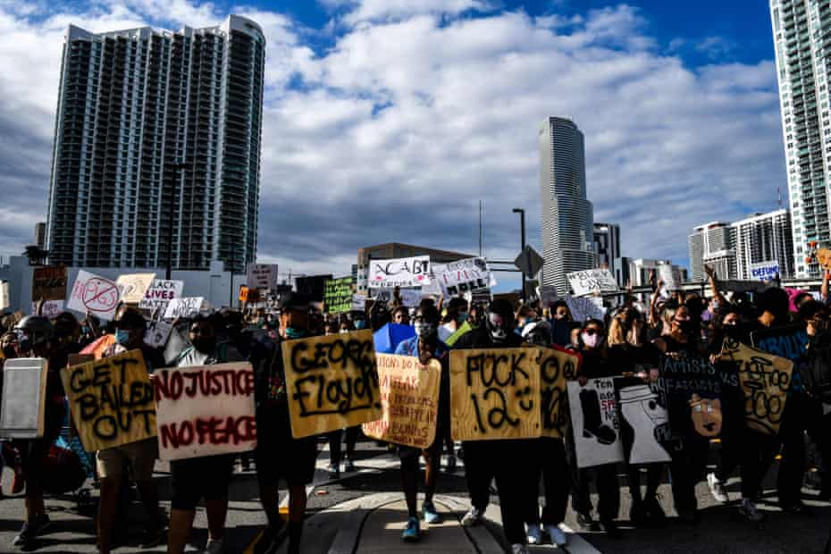 Protesters march in downtown Miami in June 2020 during a protest over the death of George Floyd.