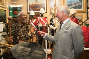 Prince Charles, Prince of Wales meets Elliot Ngubane dressed in traditional Zulu costume at the Royal Welsh Regimental Museum