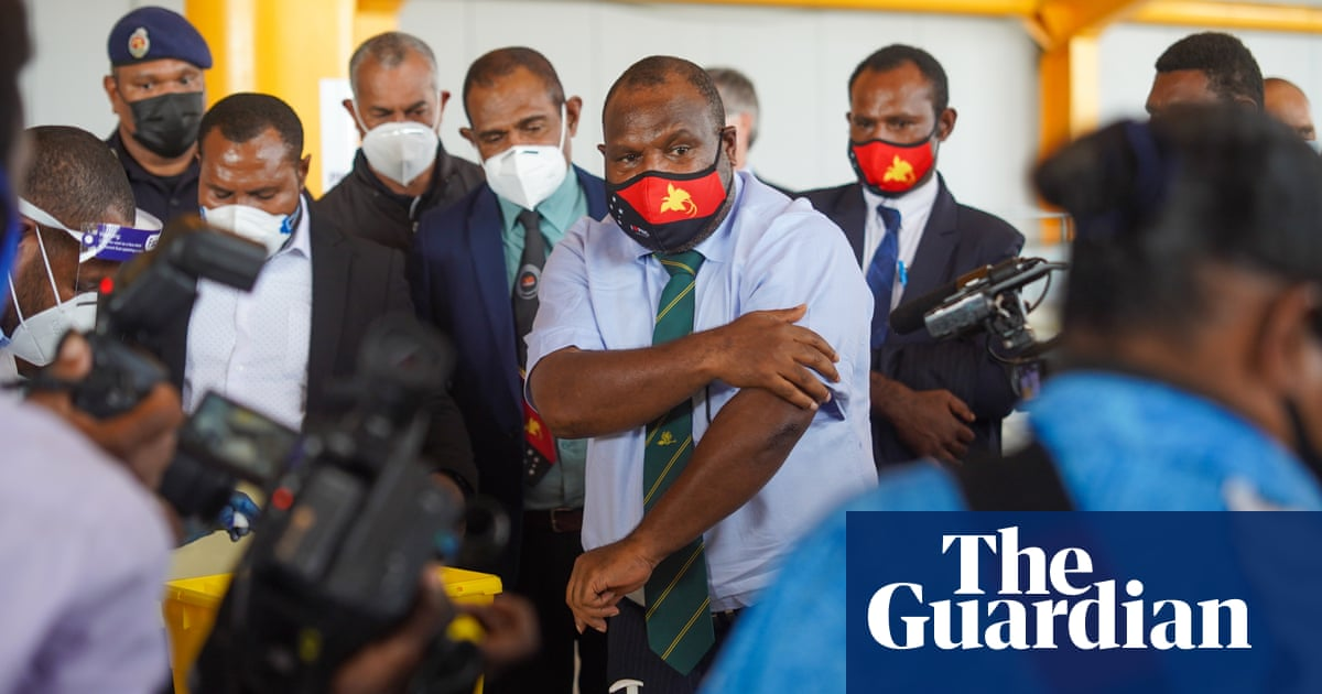 PNG prime minister first to be vaccinated with Australian-supplied doses 'to show it's safe'