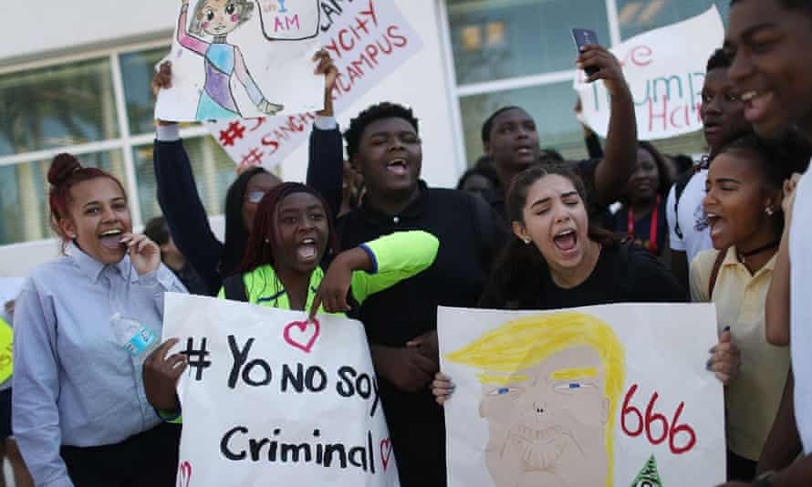 High school students in South Florida rally against Donald Trump's immigration policies and ask that their schools become 'sanctuaries'.