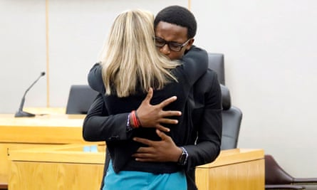 Botham Jean's younger brother Brandt Jean hugs former Dallas police officer Amber Guyger after delivering his impact statement to her following her 10-year prison sentence for murder at the Frank Crowley Courts Building in Dallas, Texas, U.S. October 2, 2019. Tom Fox/Pool via REUTERS MANDATORY CREDIT TPX IMAGES OF THE DAY