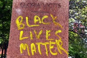 'Black lives matter' is written in yellow on the base of the Confederate Soldiers and Sailors Monument on Mount Royal Avenue in Baltimore