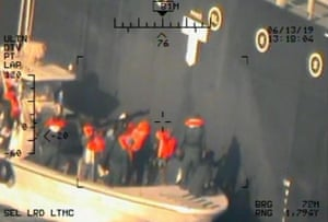 Imagery taken from a US navy helicopter of the Islamic Revolutionary Guard Corps removing an unexploded limpet mine from Kokuka Courageous.