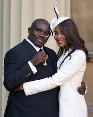Enninful receiving his OBE with Naomi Campbell