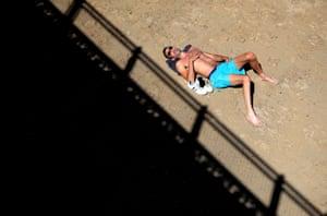 A man sunbathes on Skegness beach