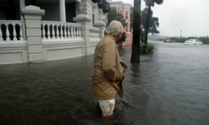 A resident emerges to inspect the flooding near White Point Gardens in Charleston, South Carolina.