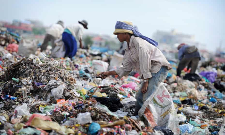 A female teenager works in Stung Meanchey slum, Cambodia, where 2,000 people live on garbage dump