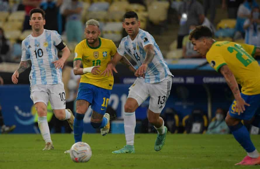 Neymar and Cristian Romero vie for the ball in the Copa América final.